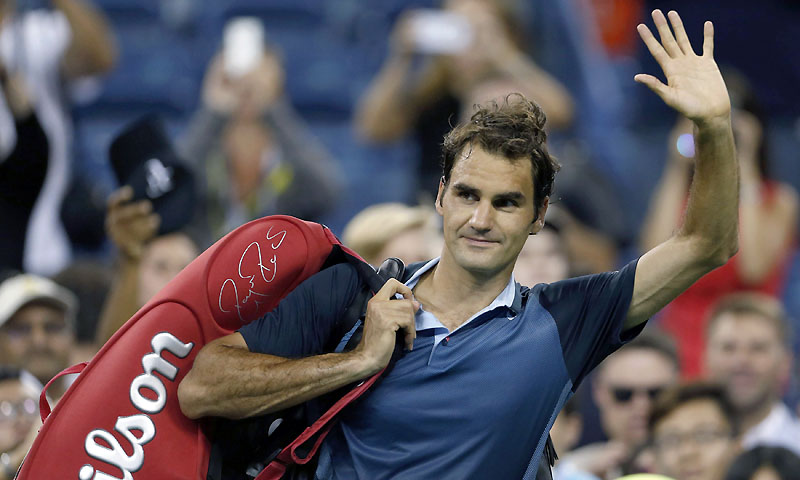 Roger Federer of Switzerland waves to fans as he leaves after defeating Adrian Mannarino of France at the US Open tennis championships in New York August 31, 2013. — Photo by Reuters