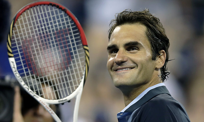 Roger Federer, of Switzerland, smiles toward the crowd after defeating Adrian Mannarino, of France, during the 2013 US Open tennis tournament, Saturday, Aug. 31, 2013, in New York. — Photo by AP