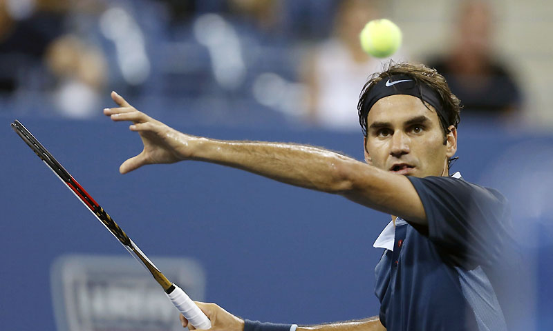Roger Federer of Switzerland comes to the net against Adrian Mannarino of France at the US Open tennis championships in New York, August 31, 2013. — Photo by Reuters