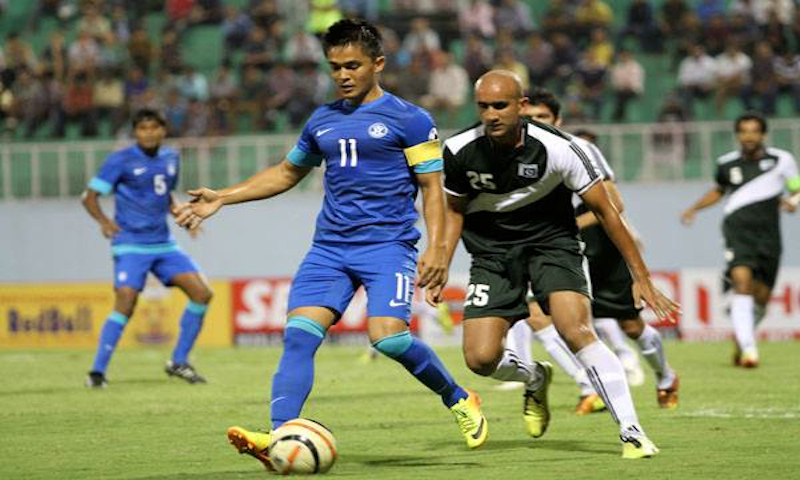 India Sunil Chetri and Pakistan's Zeeshan Rehman seen in action at the SAFF Championship.