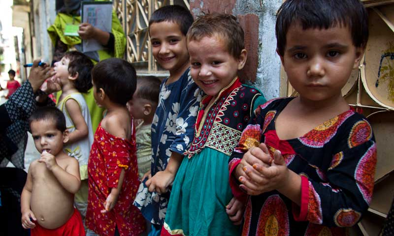 In this Aug 27, 2013, photo, children wait for their turns to be immunised against polio in Rawalpindi. — Photo by AP