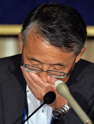 Nuclear Regulation Authority chairman Shunichi Tanaka listens to a question during a press conference at the Foreign Correspondents' Club in Tokyo on September 2, 2013. Japan's nuclear watchdog chief said on September 2 that contaminated water from the ruined Fukushima nuclear plant must be released into the ocean eventually, warning the plant remains fragile with many risks. — AFP Photo