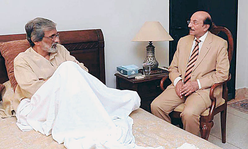 Sindh Chief Minister Syed Qaim Ali Shah meets Justice Maqbool Baqar, senior puisne judge of the Sindh High Court, at the latter's residence on Monday. Later in the day, the judicial commission recommended in Islamabad that Justice Baqar, who was wounded in a terrorist attack on June 26, be appointed SHC chief justice. — Photo by APP