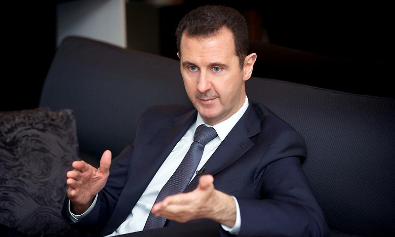 Syria's president Bashar al-Assad gestures during an interview with French daily Le Figaro in Damascus in this handout distributed by Syria's national news agency SANA on September 2, 2013.  — Photo by Reuters