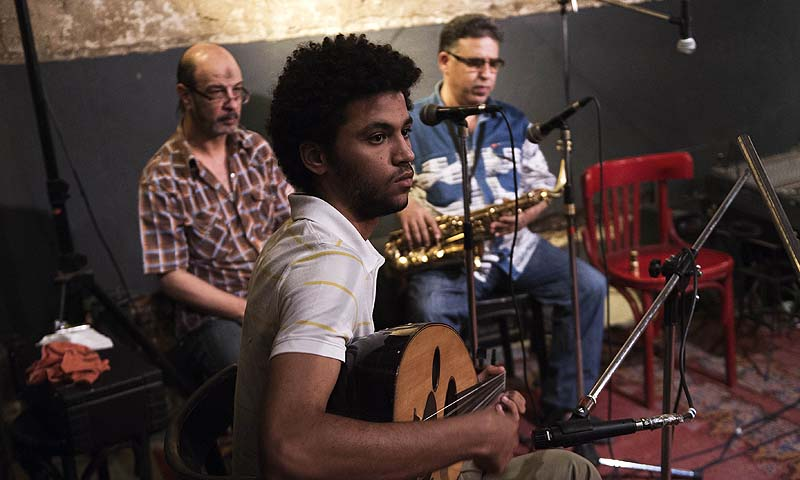 Egyptians play and listen to traditional music at the MaKan cultural centre in Cairo, minutes before the night-time curfew comes into force on August 31, 2013. — Photo AFP