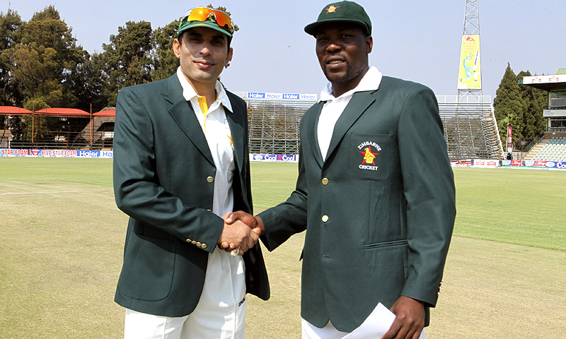 Pakistan captain Misbah-ul-Haq, left, shakes hands with Zimbabwean captain Hamilton Masakadza  before the first test match against Zimbabwe at Harare Sports Club  in Harare. -Photo by AP
