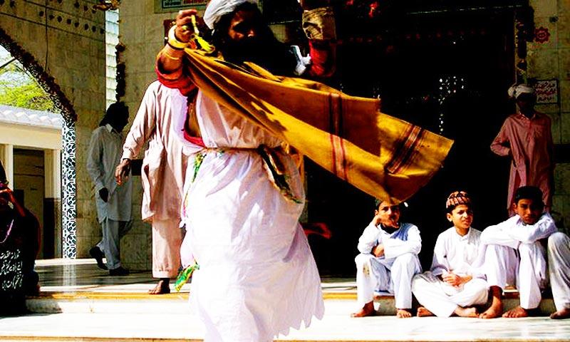 A malang dancing to a Sufi kalam being sung by other malangs at Bulleh Shah's shrine. -Photo by Bushra Shehzad/Hosh media