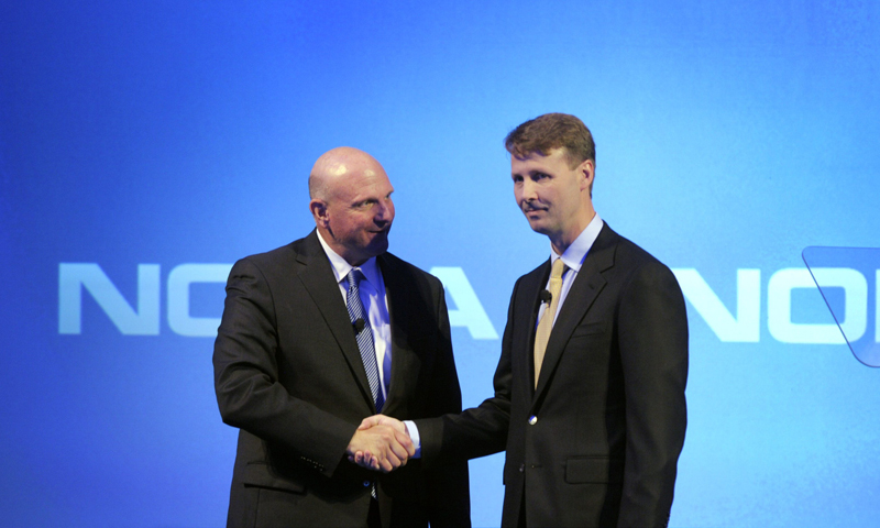 Microsoft CEO Steve Ballmer shakes hands with Nokia's Chairman of the Board Risto Siilasmaa (R) during the news conference of Finnish mobile phone manufacturer Nokia in Espoo, September 3, 2013. — Reuters Photo