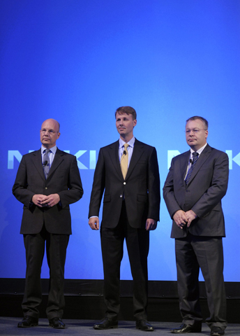 Finnish mobile phone manufacturer Nokia's new interim President Timo Ihamuotila (L), Chairman of the Board Risto Siilasmaa (C) and former CEO Stephen Elop attend the company's news conference in Espoo, September 3, 2013. Two years after hitching its fate to Microsoft's Windows Phone software, a withered Nokia collapsed into the arms of the US software giant, agreeing to sell its main handset business for 5.44 billion euros ($7.2 billion). — Reuters Photo