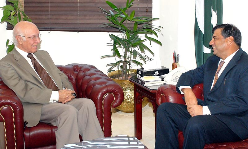 Foreign Policy and National Security Adviser Sartaj Aziz  in a meeting with Indian High Commissioner T.C.A. Raghavan. — Photo by INP
