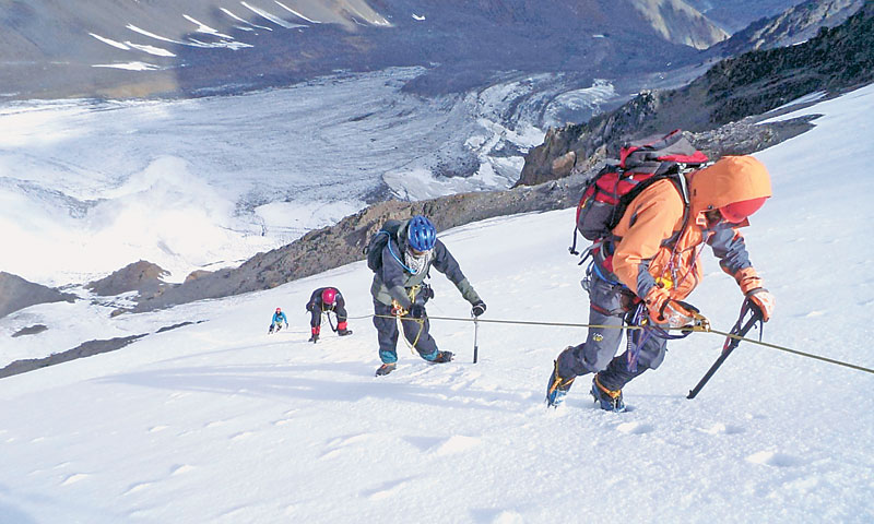 Young Pakistani mountaineers climbing Koksil V summit.