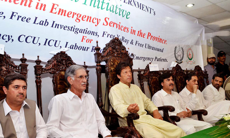 Pakistan Tehreek-i-Insaf chairman Imran Khan along with KPK Chief Minister Pervez Khattak during inaugural ceremony of Emergency Services in the province at Lady Reading Hospital. — Online photo