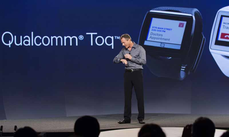 "Paul Jacobs, chairman and CEO of Qualcomm, displays the new ""Toq"" smartwatch at the Uplinq 2013 conference in San Diego, California, September 4, 2013. — Reuters Photo"