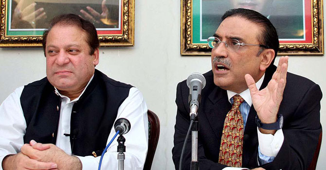 Prime Minister Nawaz Sharif (L) sitting next to President Asif Ali Zardari (R) - File Photo