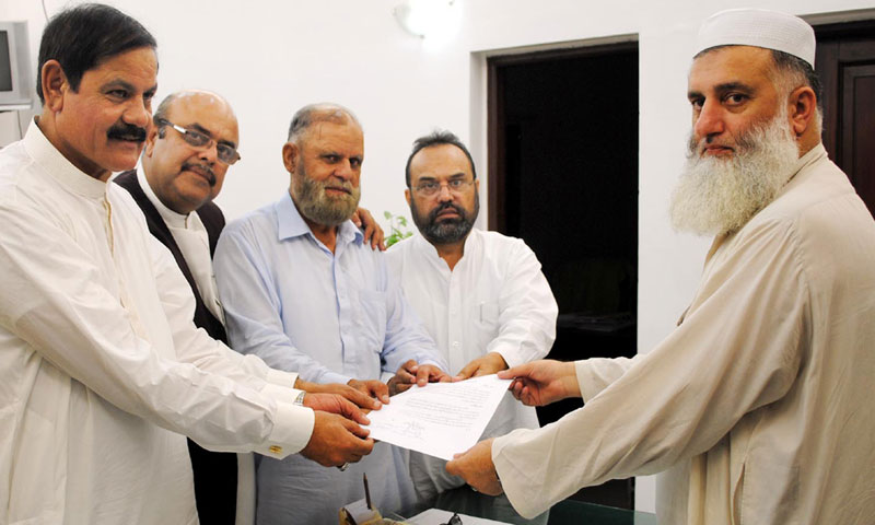 PTI MPAs from Abottabad, Qalandar Khan Lodhi, Mushtaq Ghani and Sardar Idrees submitting resolution for Hazara province at Provincial Assembly Secretariat. — Dawn File photo
