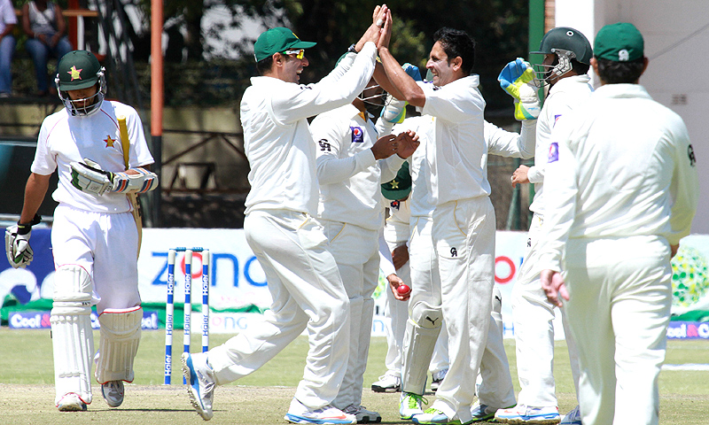 Pakistan players celebrate the wicket of Zimbabwean batsman, Sikanda Raza Butt. -Photo by AP