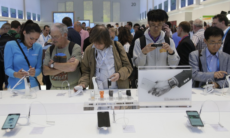 Visitors look at the latest Samsung products during the opening day of the IFA consumer electronics fair in Berlin September 6, 2013. The IFA consumer electronics and home appliances fair will open its doors to the public from September 6 till 11 in the German capital.  — Reuters Photo