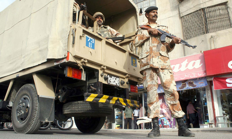 Ranger officials carry out search operation against criminals at Yousuf Plaza near Water Pump area in Karachi on Saturday, September 07, 2013. – PPI Photo