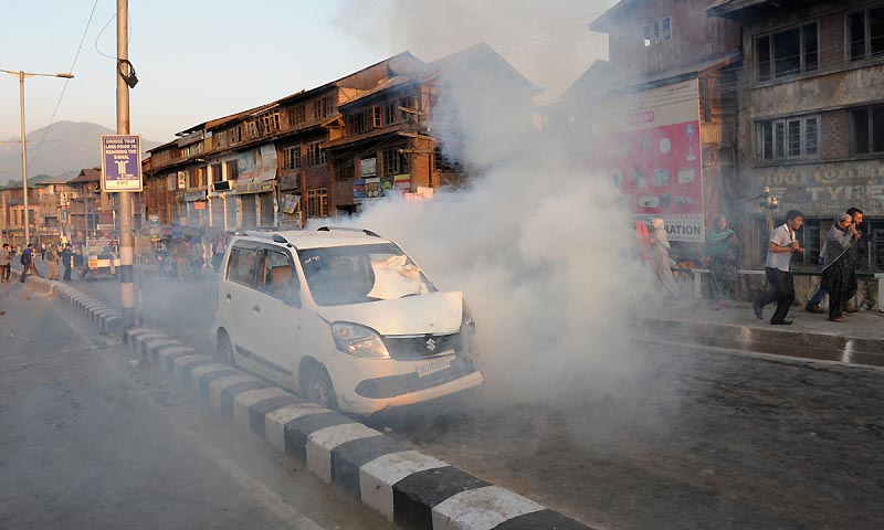 Indian police throw tear gas towards protesters  during a protest in Srinagar on September 7,2013. — Photo by AFP