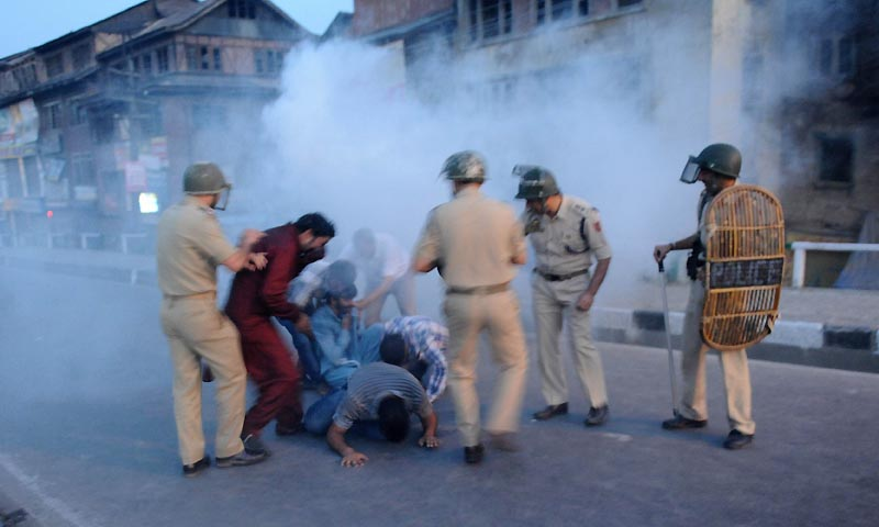 Indian police throw tear gas canister towards Chairman of Jammu and Kashmir Liberation Front, Yasin Malik and supporters during a protest  in Srinagar on September 7,2013. — Photo by AFP