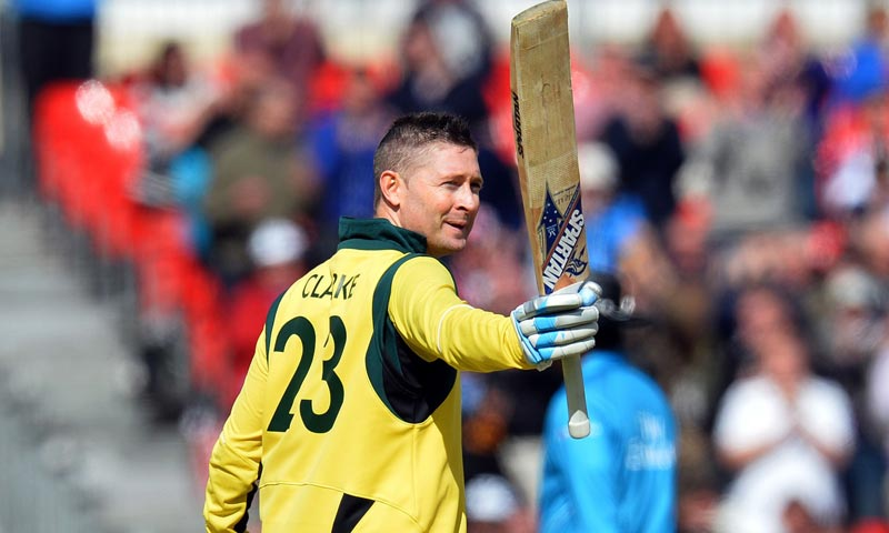Australia's Michael Clarke celebrates reaching his century during the second one day international (ODI) cricket match between England and Australia at Old Trafford in Manchester. -AFP Photo