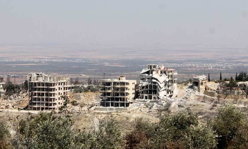 A general view of damaged buildings is seen as a result of shelling from forces loyal to President Bashar al-Assad, according to activists, in Ariha countryside, Sept 7, 2013. — Photo by Reuters