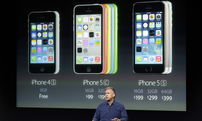 Phil Schiller, Apple's senior vice president of worldwide product marketing, speaks on stage during the introduction of the new iPhone 5c and 5s in Cupertino, Calif., Tuesday, Sept. 10, 2013. — AP Photo