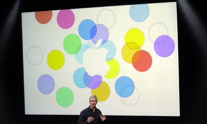 "Tim Cook, CEO of Apple, speaks on stage before the introduction of new products in Cupertino, Calif., Tuesday, Sept. 10, 2013. Apple's latest iPhones will come in a bevy of colors and two distinct designs, one made of plastic and the other that aims to be ""the gold standard of smartphones"" and reads your fingerprint. — AP Photo"