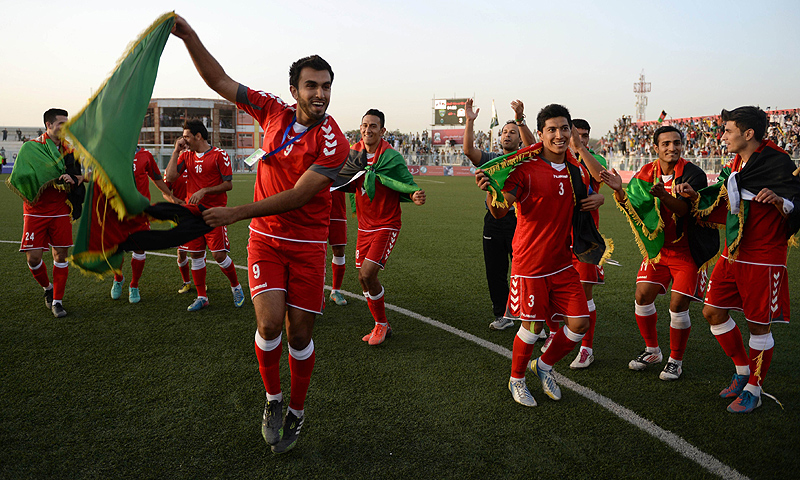 The Afghan squad led by coach Yousef Kargar danced on the field with their nation's flag held aloft, before doing a lap of honour in front of an appreciative crowd. -Photo by AFP