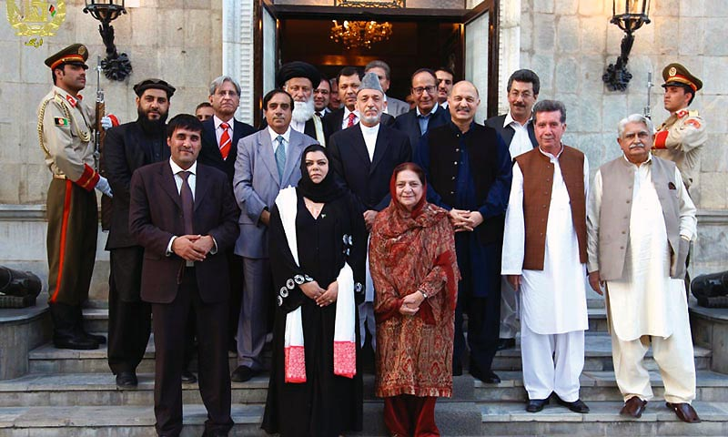 Members of the Senate Defence Committee delegation led by Senator Mushahid Hussain pictured with Afghan president Karzai here on Wednesday. The delegation includes representatives of major political parties, including Chaudhry Shujaat Hussain, Chaudhry Aitzaz Ahsan, Afrasiab Khattak, Jahangir Badr, Haji Adeel, Sehr Kamran and Saeedul Hassan Mandokhail. — Photo by INP