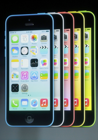 The five colors of the new iPhone 5C are seen on screen at Apple Inc's media event in Cupertino, California September 10, 2013. — Reuters Photo