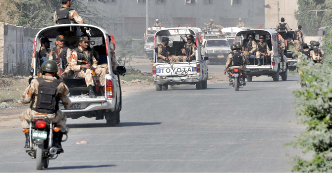 Rangers vehicles head towards an area in the city to conduct a targeted operation - File Photo