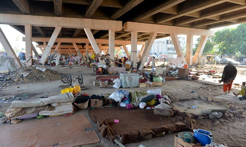 Life under the Nazimabad Petrol Pump flyover.
