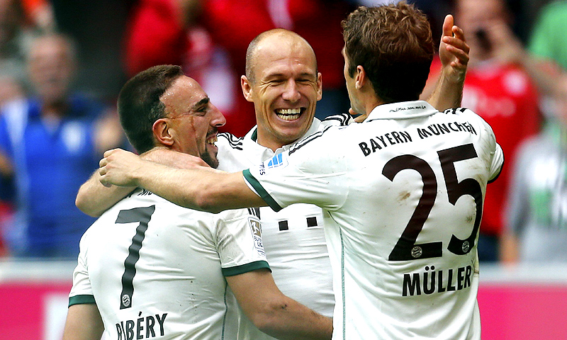 Franck Ribery, Arjen Robben and Thomas Mueller (L-R) of FC Bayern Munich celebrate Munich's second goal against Hanover 96 during their German first division Bundesliga match. -Photo by Reuters