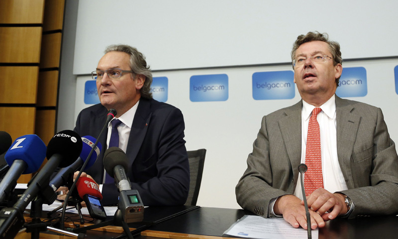 Belgian Minister for Public Enterprises and Development Cooperation Jean-Pascal Labille (L) and Didier Bellens, chief executive officer of Belgium's telecom operator Belgacom hold a joint news conference at Belgacom headquarters in Brussels September 16, 2013. Belgium said on Monday it was investigating suspected foreign state espionage against its main telecoms company, which is the top carrier of voice traffic in Africa and the Middle East, and a newspaper pointed the finger at the United States. — Reuters Photo