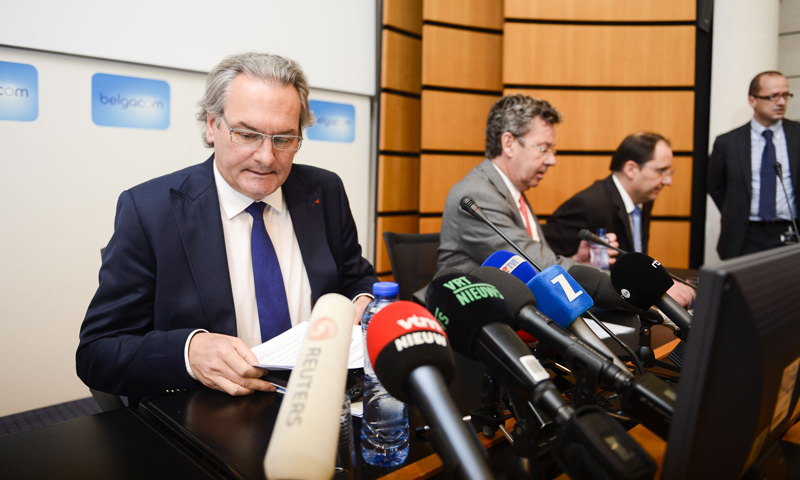Belgian Public Enterprises and Development Cooperation Minister Jean-Pascal Labille (L) and the chief executive officer of Belgium state-owned telephone operator Belgacom, Didier Bellens (C), give a press conference on September 16, 2013 about  the digital burglary into Belgacom's computer systems at company headquarters in Brussels. — AFP Photo