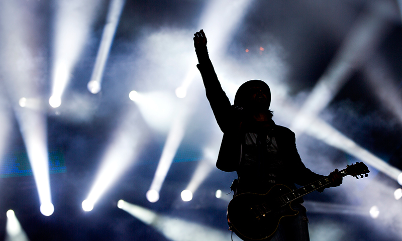 Guitar player Marco Tulio of Brazilian band Jota Quest performs during the Rock in Rio music festival in Rio de Janeiro, Brazil, Sunday, Sept. 15, 2013. The week long festival will feature a list of headliners including Muse, Justin Timberlake, Metallica, Bon Jovi, and Bruce Springsteen. - Photo by AP