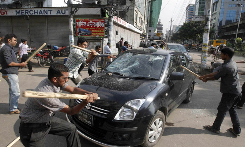 Activists of the Jamaat-e-Islami party vandalise a car upon hearing the revised sentencing of Abdul Quader Mollah, assistant secretary general of the party, in Dhaka September 17, 2013.   — Photo by Reuters
