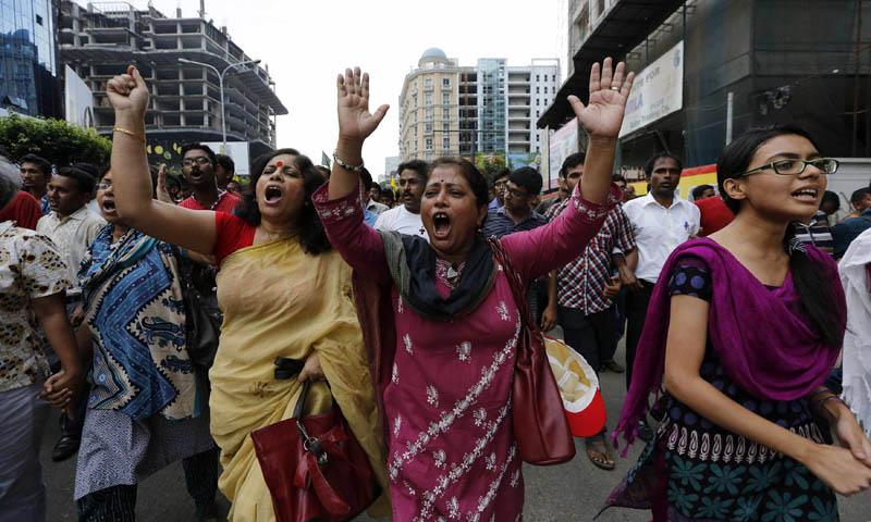 People shout slogans as they celebrate after hearing the revised sentencing of Abdul Quader Mollah, assistant secretary general of the outlawed Jamaat-e-Islami party, in Dhaka September 17, 2013. — Photo by Reuters