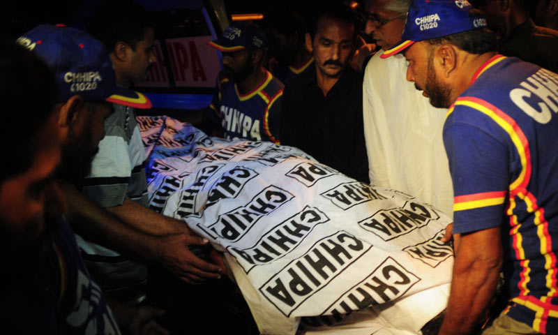 Volunteers carry the body of Zafar Baloch, a prominent member of the banned Peoples' Aman Committee, who was killed in an attacked by gunmen in Karachi. -AFP Photo
