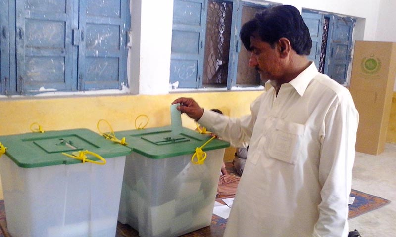 Man casting his vote during by-elections at NA-25.  — Photo by Online