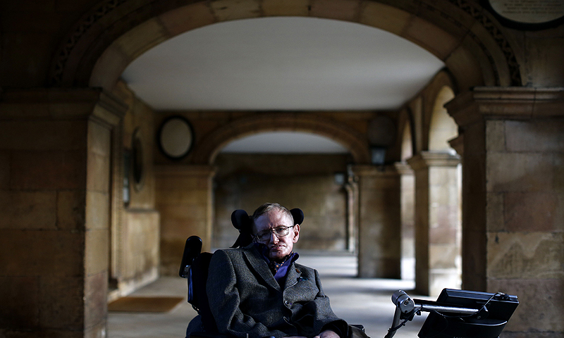Theoretical physicist Stephen Hawking poses for a picture ahead of a gala screening of the documentary film 'Hawking', a film about his life, at the opening night of the Cambridge Film Festival in Cambridge, eastern England on September 19, 2013. - Photo by AFP