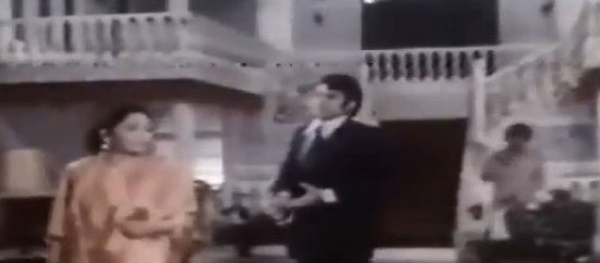 The ubiquitous rich people's twin staircase. (1974's Uff Yeh Biweean').