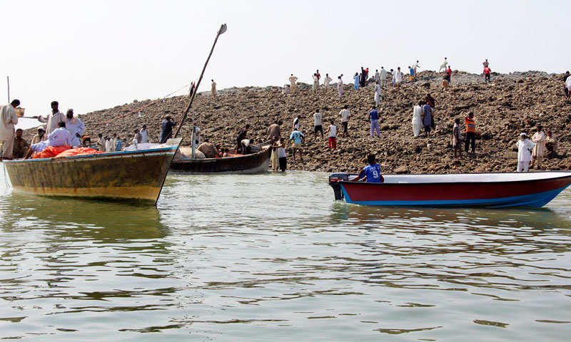 Visitors keenly exploring the island that rose from the sea following the Awaran earthquake. –Photo by Reuters