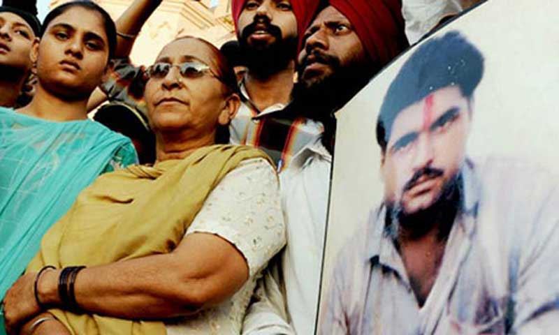 File photo shows relatives of Sarabjit Singh. — File photo