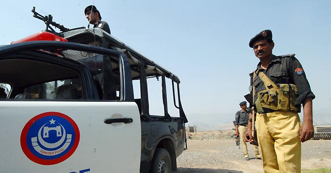 KP Police stands guard outside a government building in Peshawar - File Photo