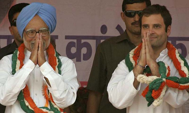 PM Singh (left) with Rahul Gandhi during a rally in Uttar Pradesh state in 2011. — Photo AFP