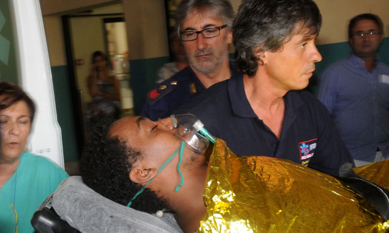 A man receives assistance at the Palermo Civico hospital, Italy, Thursday, Oct. 3, 2013 after being rescued off the Italian island of Lampedusa. -AP Photo