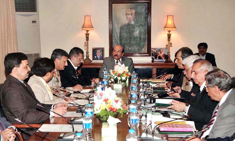 Sindh Chief Minister Syed Qaim Ali Shah presiding over a meeting to review law and order situation in Province at CM House.   — Photo by APP