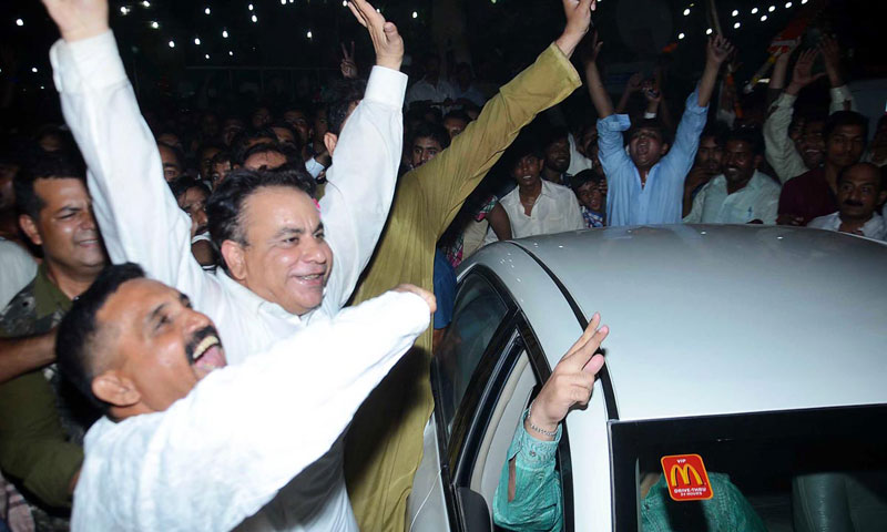 PTI's candidate for PP-72 Sheikh Khurram Shahzad celebrates with his supporters after winning the PP-72 by-election in Faisalabad on Monday night. – Photo by Online